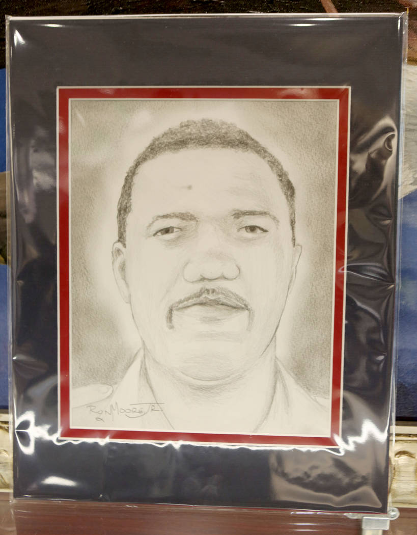 Ohio-based artist Ron Moore Jr. unveiled a portrait of Charleston Hartfield at Metropolitan Police Department headquarters in Las Vegas, Tuesday, Nov. 14, 2017. Hartfield was one of 58 killed duri ...