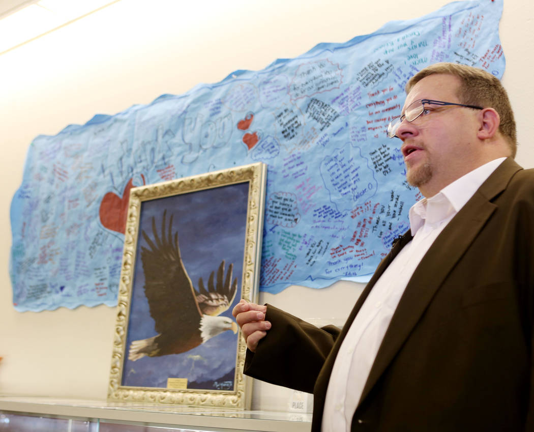 Ohio-based artist Ron Moore Jr. explains his painting of an eagle at Metropolitan Police Department headquarters in Las Vegas, Tuesday, Nov. 14, 2017. Moore gifted the painting to Metro for their  ...