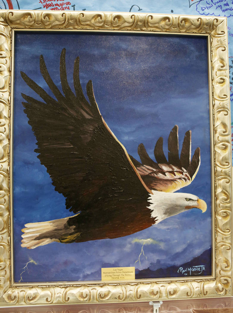 A painting of an eagle flying through a storm created by Ohio-based artist Ron Moore Jr. is on display at Metropolitan Police Department headquarters in Las Vegas, Tuesday, Nov. 14, 2017. Moore gi ...