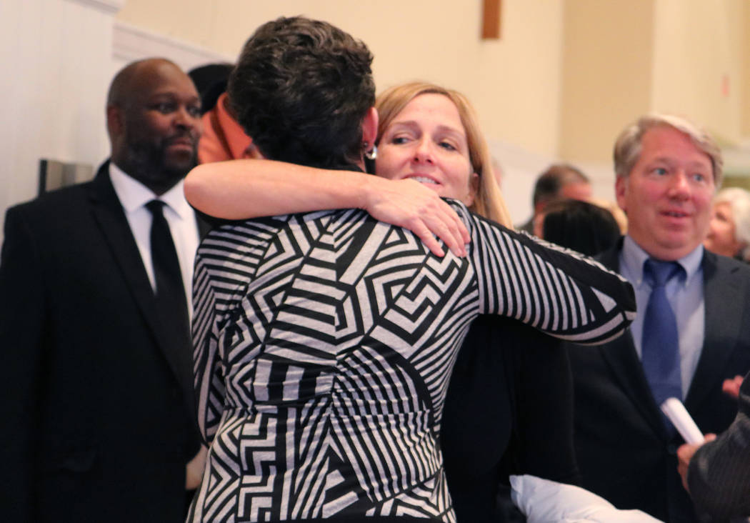 Maribeth Starr, back, offers her condolences to Mary Berger after Stephen Berger's memorial service in Wauwatosa, Wis., on Nov. 10, 2017. Rio Lacanlale Las Vegas Review-Journal