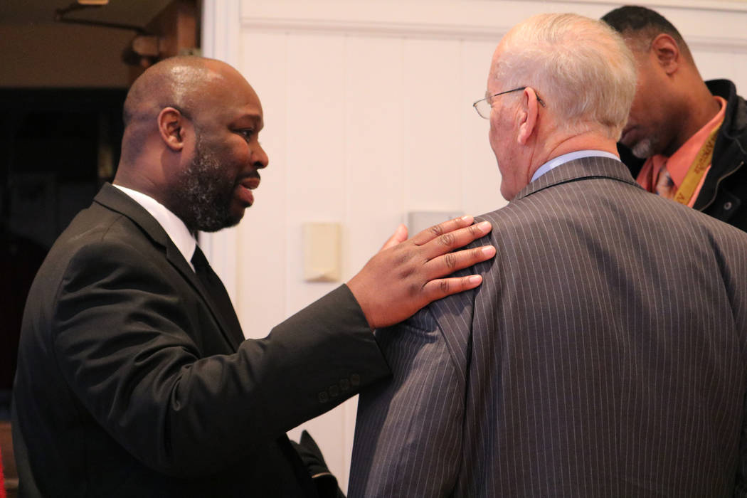 Chivas Owens, left, offers his condolences to Richard Berger after Stephen Berger's memorial service in Wauwatosa, Wis., on Nov. 10, 2017. Rio Lacanlale Las Vegas Review-Journal