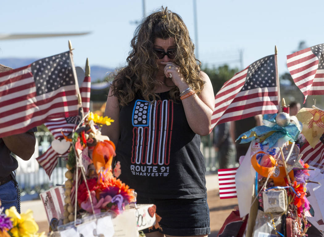 A woman wipes away tears while visiting a memorial for Route 91 Harvest shooting victims at the Welcome to Fabulous Las Vegas sign, Thursday, Nov. 9, 2017. Richard Brian Las Vegas Review-Journal @ ...