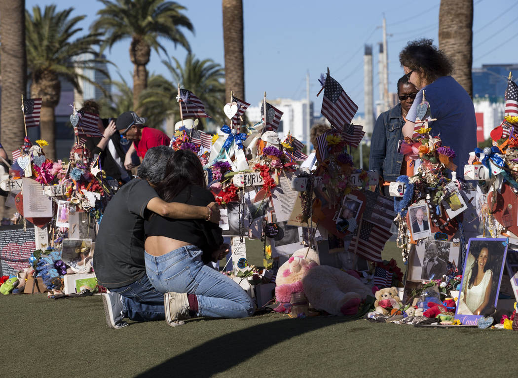 A couple comforts each other while visiting a memorial for Route 91 Harvest shooting victims at the Welcome to Fabulous Las Vegas sign, Thursday, Nov. 9, 2017. Richard Brian Las Vegas Review-Journ ...