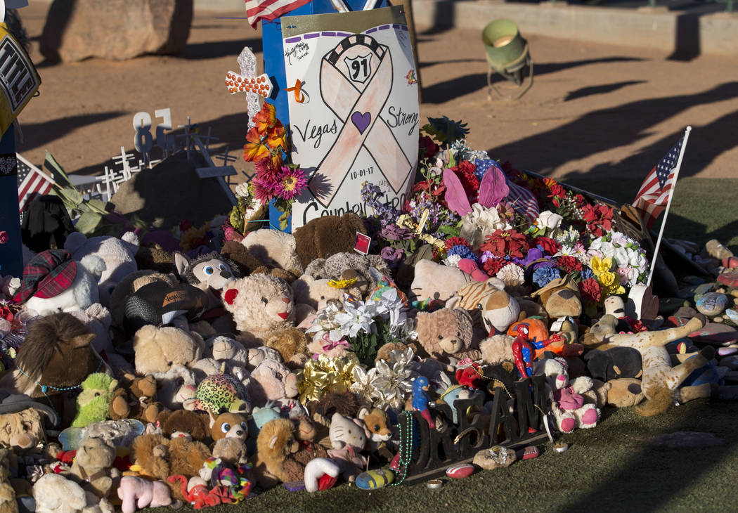 Messages, flowers, and other mementos left behind at a memorial for Route 91 Harvest shooting victims at the Welcome to Fabulous Las Vegas sign, Thursday, Nov. 9, 2017. Richard Brian Las Vegas Rev ...