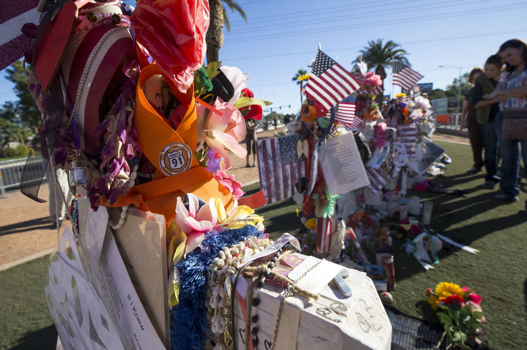 People visit a memorial for Route 91 Harvest shooting victims at the Welcome to Fabulous Las Vegas sign, Thursday, Nov. 9, 2017. Richard Brian Las Vegas Review-Journal @vegasphotograph