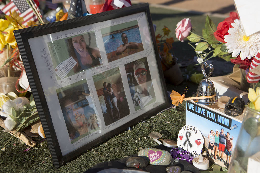 "People leave candles, notes, flowers and other small mementos at a makeshift memorial at the ""Welcome to Fabulous Las Vegas"" sign in Las Vegas on Tuesday, Oct. 31, 2017. Bridget  ..."