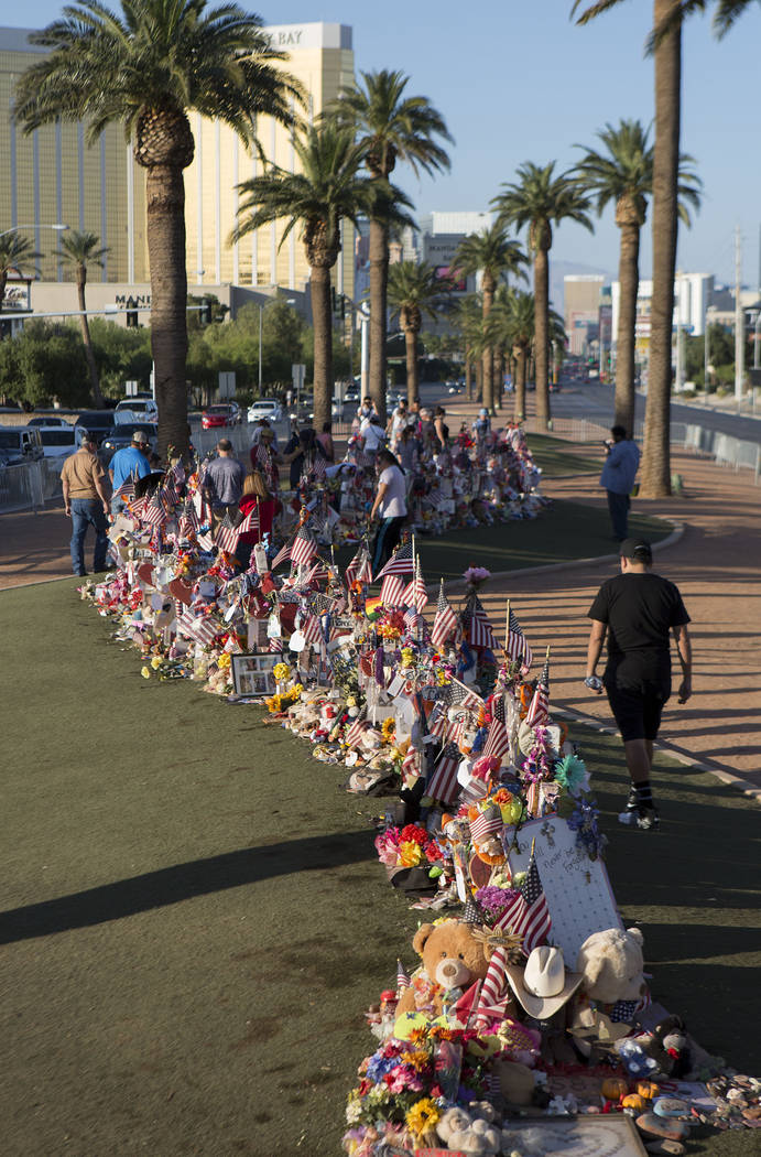 "People visit the 58 crosses at a makeshift memorial at the ""Welcome to Fabulous Las Vegas"" sign in Las Vegas on Tuesday, Oct. 31, 2017. Bridget Bennett Las Vegas Review-Journal @ ..."