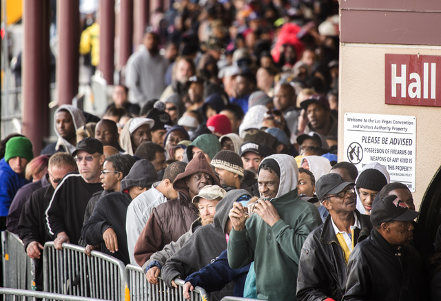 People line up during annual Project Homeless Connect at Cashman Center, 850 Las Vegas Boulevard North, on Wednesday, November 19, 2014. (Jeff Scheid/Las Vegas Review-Journal)