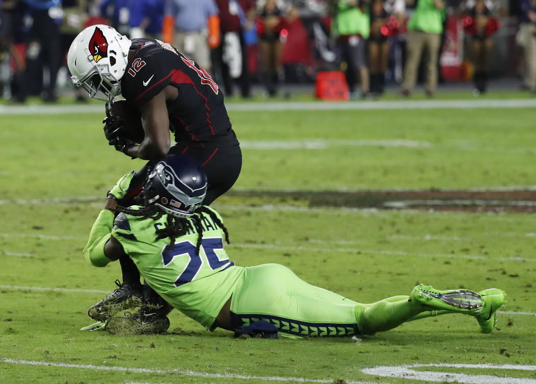 Seattle Seahawks cornerback Richard Sherman (25) tackles Arizona Cardinals wide receiver John Brown (12) during the second half of an NFL football game, Thursday, Nov. 9, 2017, in Glendale, Ariz.  ...