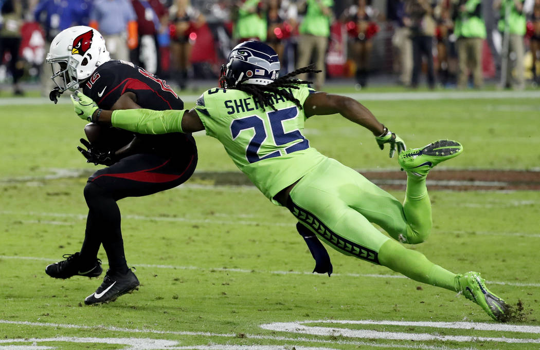 Seattle Seahawks cornerback Richard Sherman (25) tackles Arizona Cardinals wide receiver John Brown (12) during the second half of an NFL football game against the Arizona Cardinals, Thursday, Nov ...