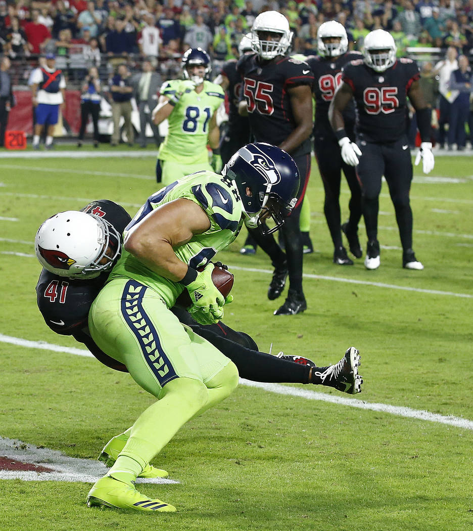 Seattle Seahawks tight end Jimmy Graham pulls in a touchdown pass as Arizona Cardinals strong safety Antoine Bethea (41) defends during the second half of an NFL football game, Thursday, Nov. 9, 2 ...