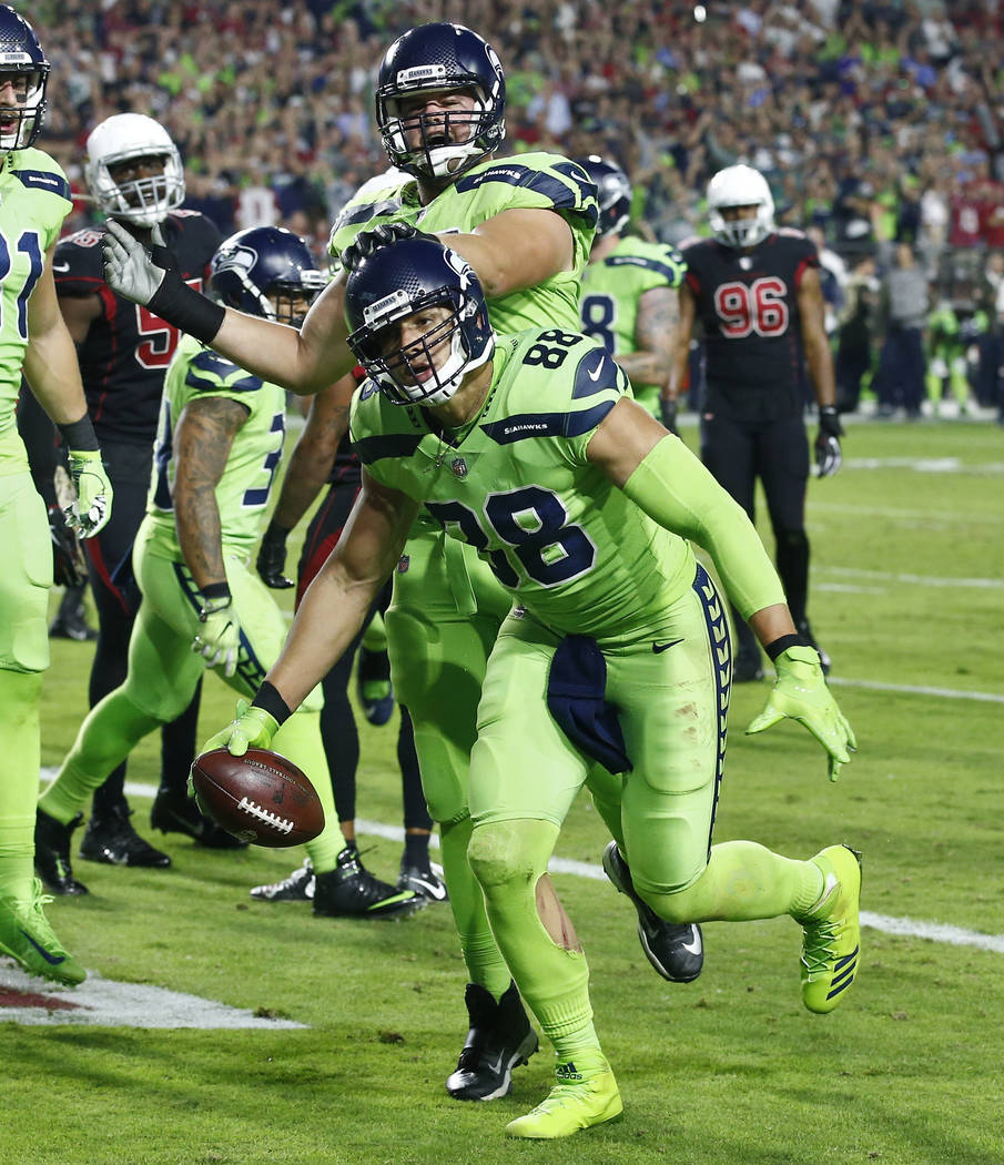 Seattle Seahawks tight end Jimmy Graham (88) celebrates his touchdown catch against the Arizona Cardinals during the second half of an NFL football game, Thursday, Nov. 9, 2017, in Glendale, Ariz. ...