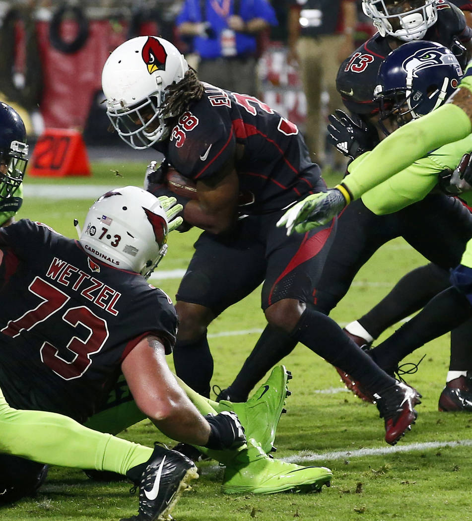 Arizona Cardinals running back Andre Ellington (38) scores a touchdown against the Seattle Seahawks during the second half of an NFL football game, Thursday, Nov. 9, 2017, in Glendale, Ariz. (AP P ...