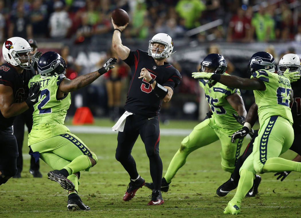 Arizona Cardinals quarterback Drew Stanton (5) throws against the Seattle Seahawks during the second half of an NFL football game, Thursday, Nov. 9, 2017, in Glendale, Ariz. (AP Photo/Ross D. Fran ...