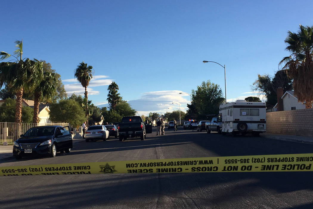 Las Vegas police investigate in the 7300 block of Newcrest Circle near Flamingo Road and Tenaya Way Monday, Nov. 6, 2017, where an unresponsive man was found lying down in a home's front ya ...