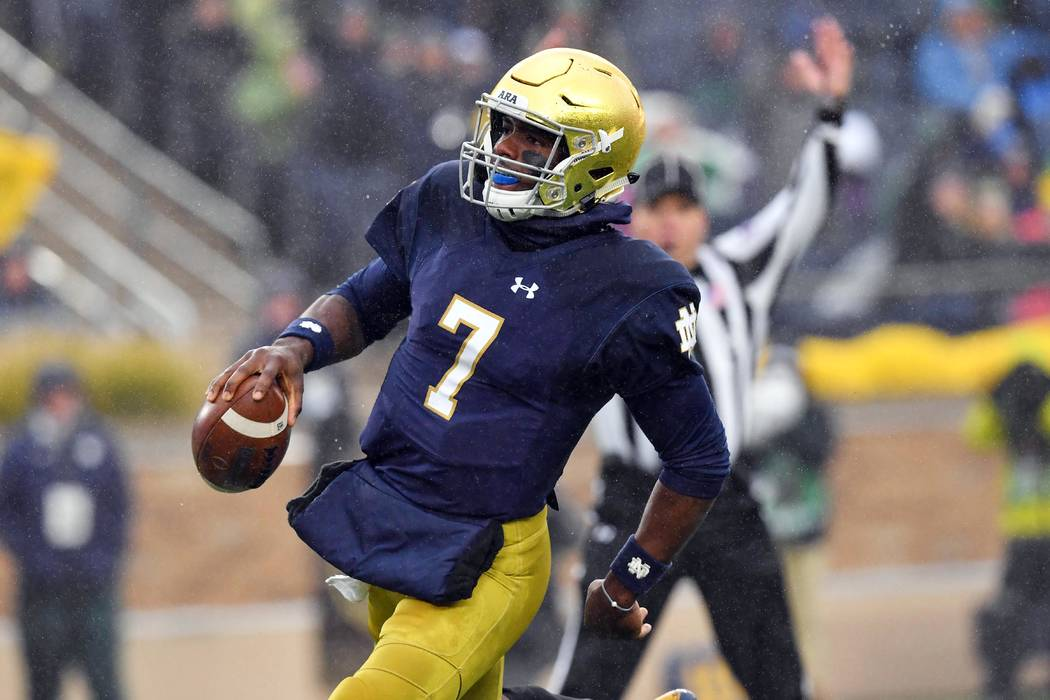 Nov 4, 2017; South Bend, IN, USA; Notre Dame Fighting Irish quarterback Brandon Wimbush (7) scores a touchdown in the second quarter against the Wake Forest Demon Deacons at Notre Dame Stadium. Ma ...