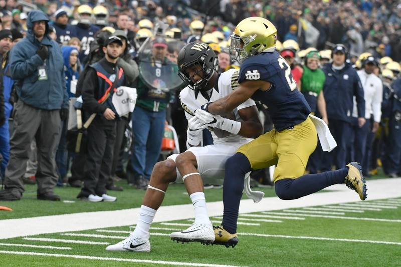Nov 4, 2017; South Bend, IN, USA; Wake Forest Demon Deacons wide receiver Scotty Washington (7) catches a pass as Notre Dame Fighting Irish cornerback Julian Love (27) defends in the first quarter ...
