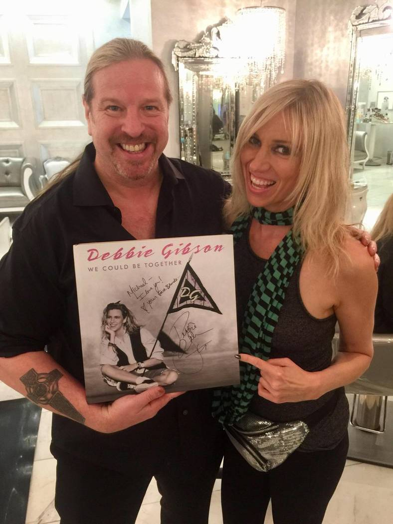 Pop star Debbie Gibson gives Michael Boychuck, colorist to the stars, a souvenir book that contained one each of all her CDs and singles that she's recorded over the years.