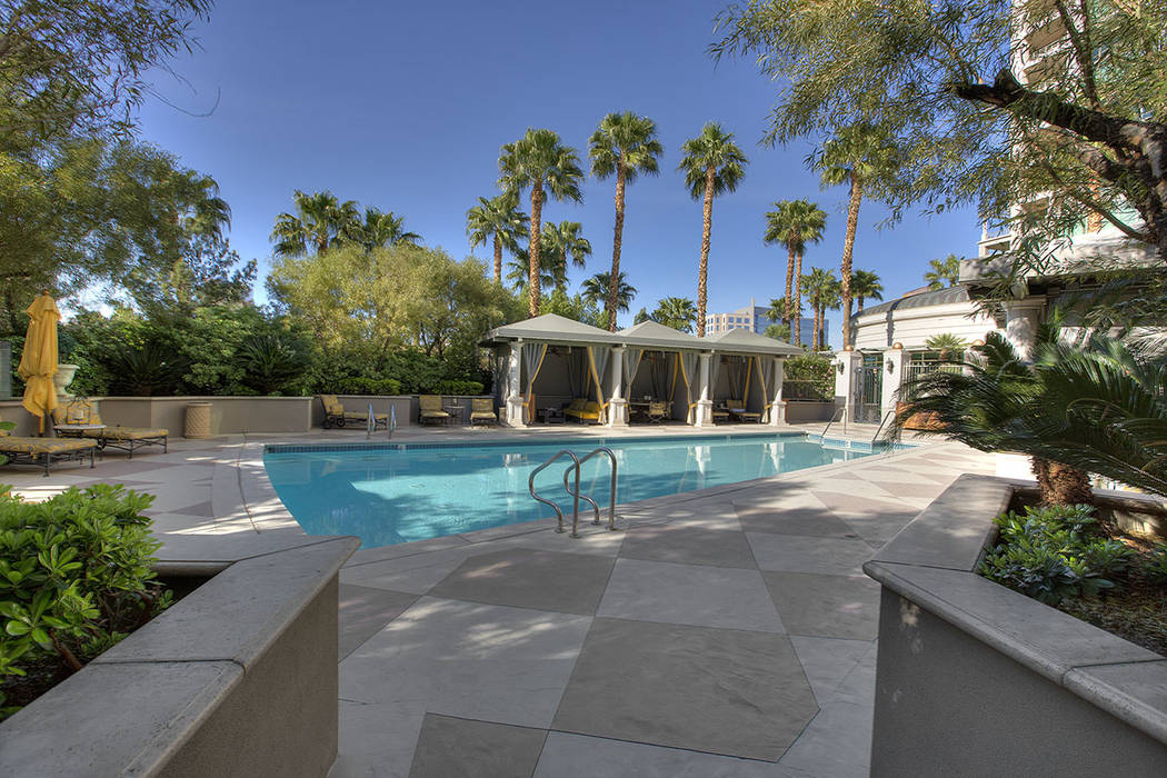 The pool area is near the garden.  (Synergy|Sotheby's International Realty)