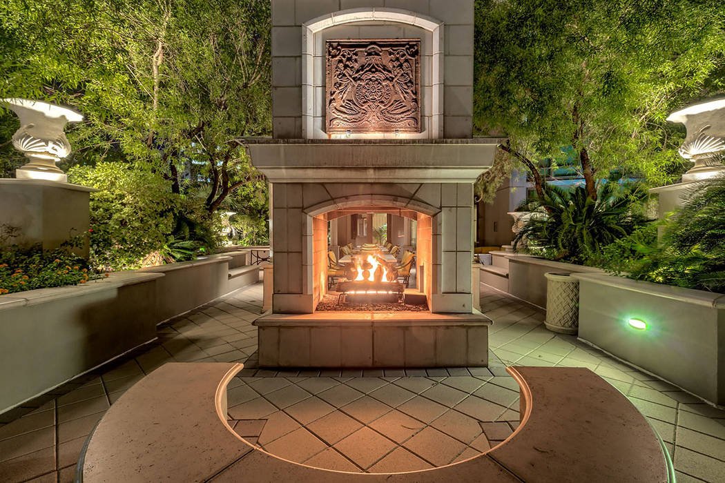 Near the garden is a fire feature. (Synergy|Sotheby's International Realty)