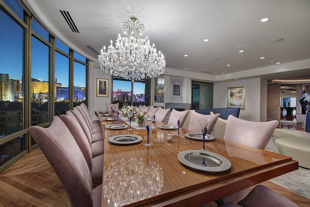 A formal dining room is in one of the Park Towers units that were combined to create a large living space on the second floor of one of the high-rise buildings. (Synergy|Sotheby's International  ...