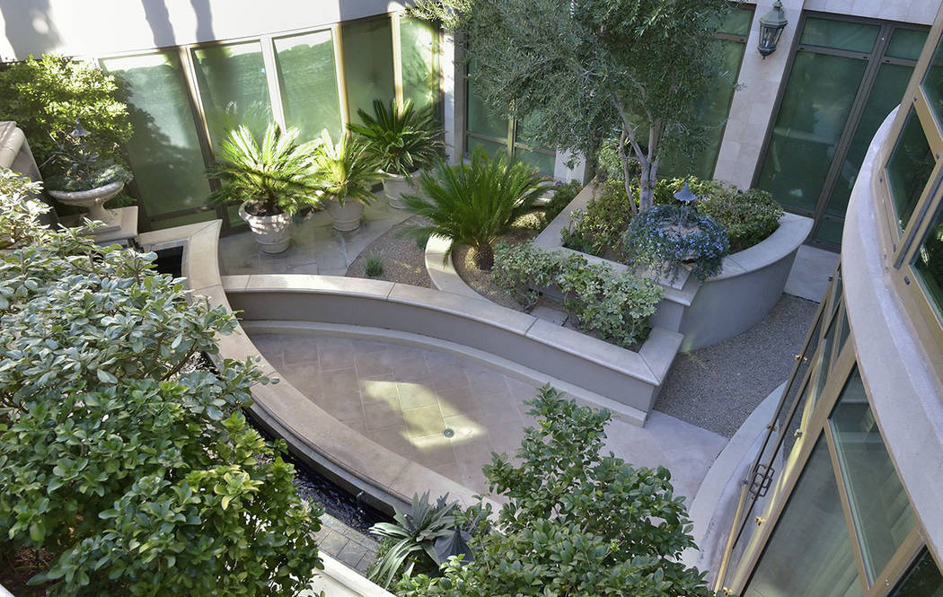 Bill Hughes Real Estate Millions  The home opens to Park Towers' garden.