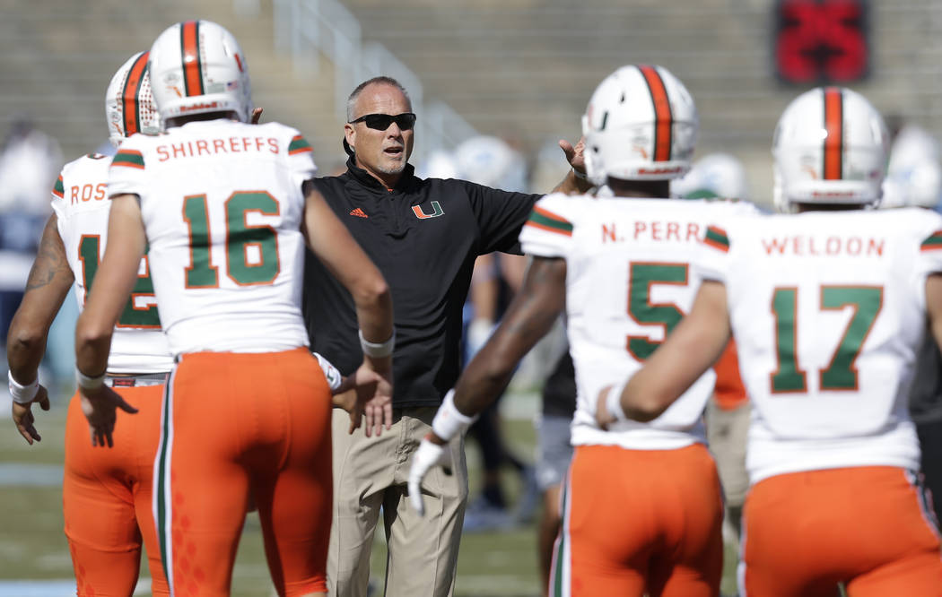 Miami head coach Mark Richt watches his team warm up prior to an NCAA college football game against North Carolina in Chapel Hill, N.C., Saturday, Oct. 28, 2017. (AP Photo/Gerry Broome)