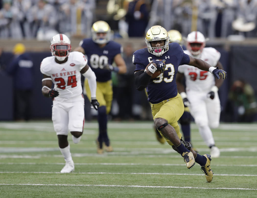 Notre Dame running back Josh Adams runs during the first half of an NCAA college football game against North Carolina State, Saturday, Oct. 28, 2017, in South Bend, Ind. (AP Photo/Darron Cummings)
