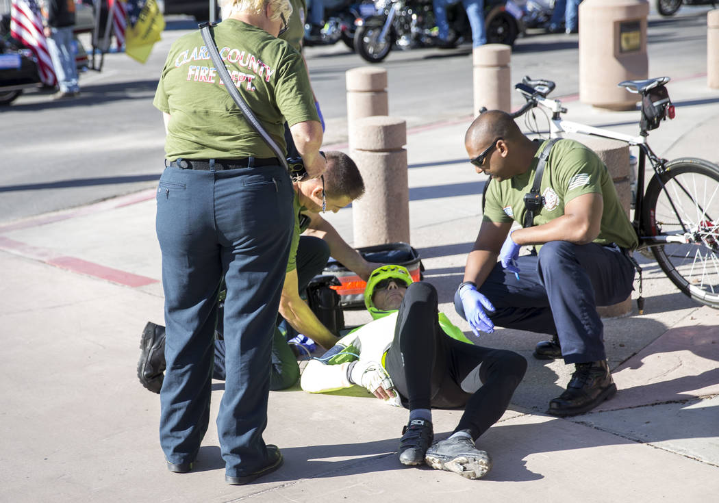 A cyclist is helped by medical personnel after leaving the starting line during the Project Hero Honor Ride in Las Vegas, Saturday, Nov. 11, 2017. Over 700 riders participated in the non-competiti ...