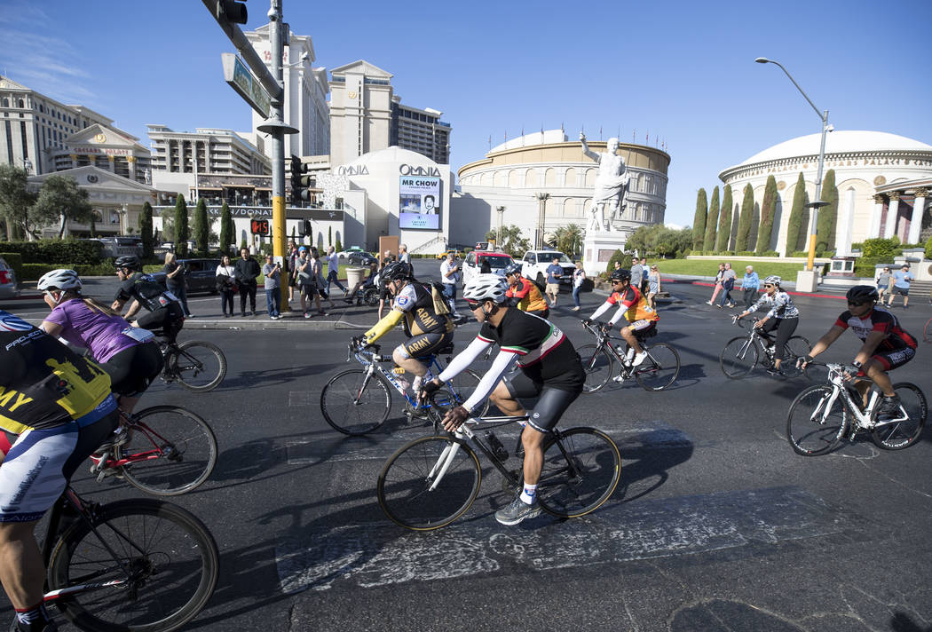 Participants ride past Caesars Palace along southbound Las Vegas Boulevard during the Project Hero Honor Ride in Las Vegas, Saturday, Nov. 11, 2017. Over 700 riders participated in the non-competi ...