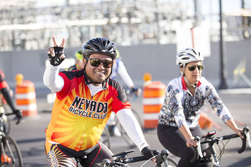 Participants ride through downtown  during the Project Hero Honor Ride in Las Vegas, Saturday, Nov. 11, 2017. Over 700 riders participated in the non-competitive race to raise funds and bring awar ...