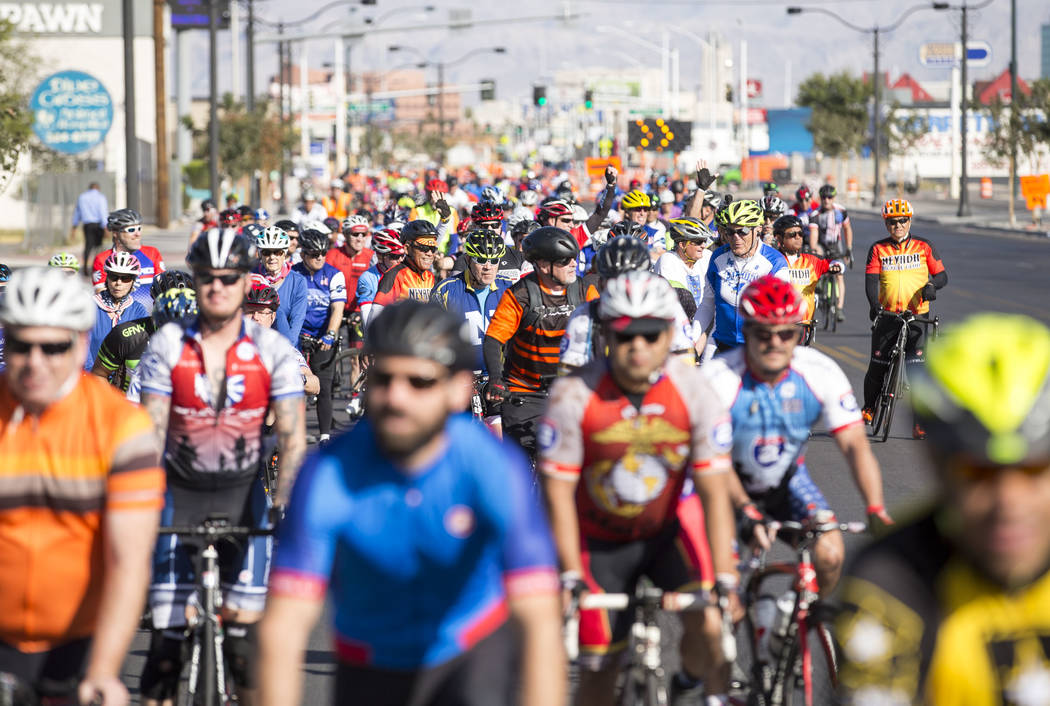 Participants ride through downtown during the Project Hero Honor Ride in Las Vegas, Saturday, Nov. 11, 2017. Over 700 riders participated in the non-competitive race to raise funds and bring aware ...