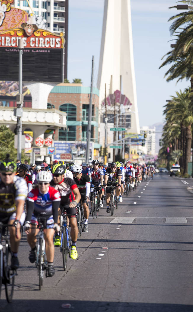 Participants ride along southbound Las Vegas Boulevard during the Project Hero Honor Ride in Las Vegas, Saturday, Nov. 11, 2017. Over 700 riders participated in the non-competitive race to raise f ...