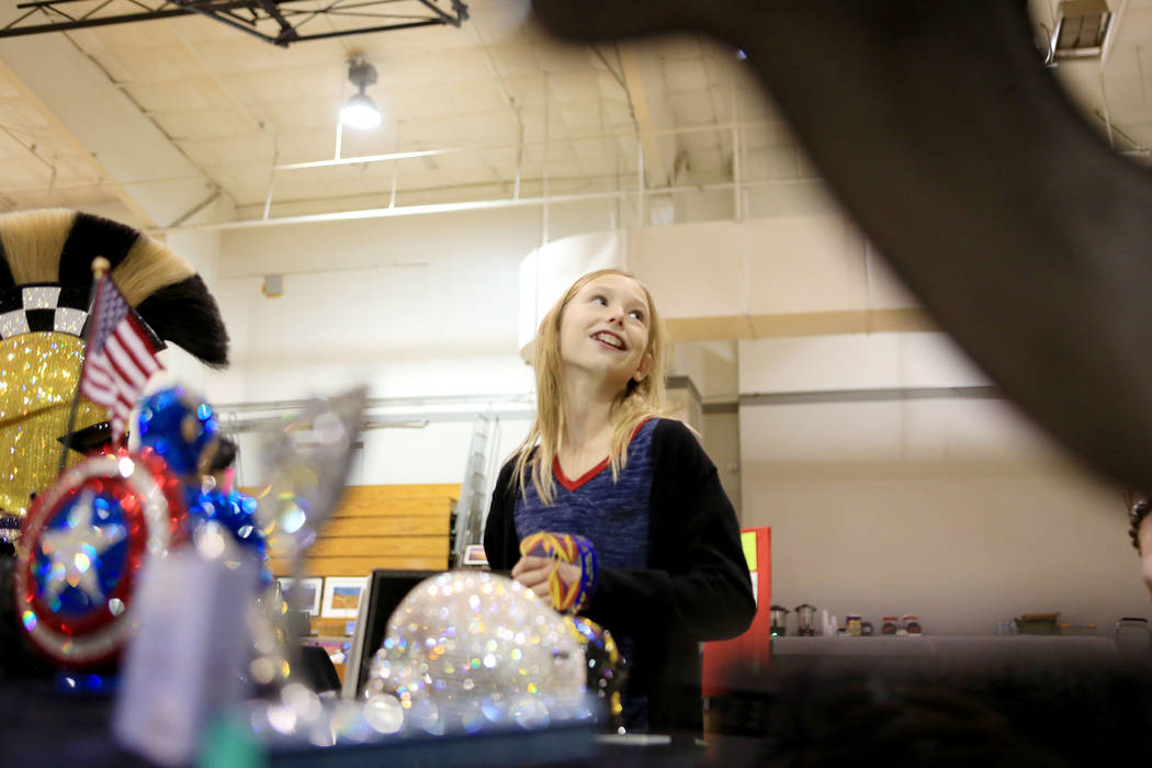 Lyndsey Haff, 11, admires Black Raven crystal art designs by Dana Notario during the Winter Art Festival in the Boulder City Parks and Recreation gym in Boulder City, Sunday, Nov. 12, 2017. Elizab ...