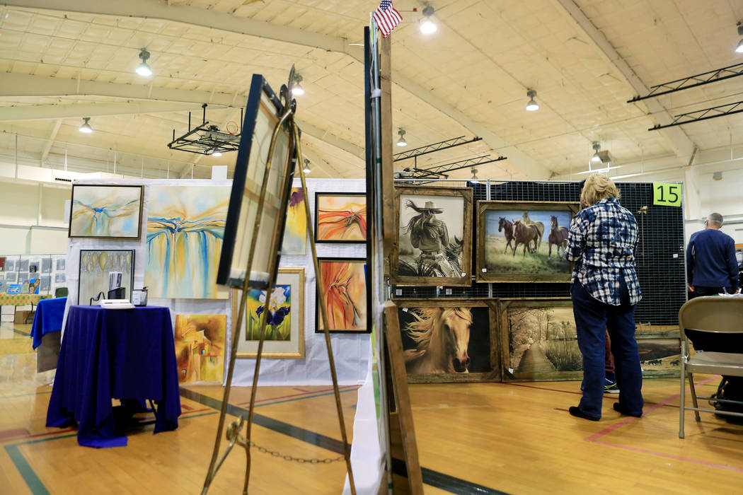 Individuals browse through different displays of art during the Winter Art Festival in the Boulder City Parks and Recreation gym in Boulder City, Sunday, Nov. 12, 2017. Elizabeth Brumley Las Vegas ...