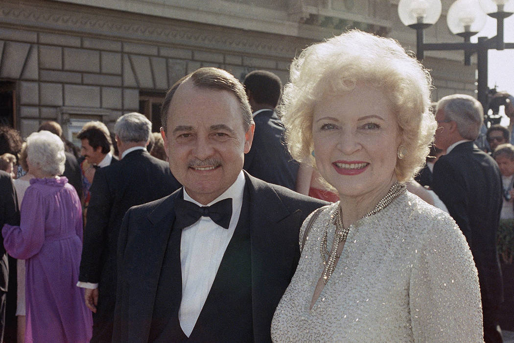 This Sept. 22, 1985, file photo shows John Hillerman, left, and Betty White, right, arriving at Emmy Awards in Pasadena, Calif. A spokeswoman for the family of Hillerman says the co-star of TV's ...