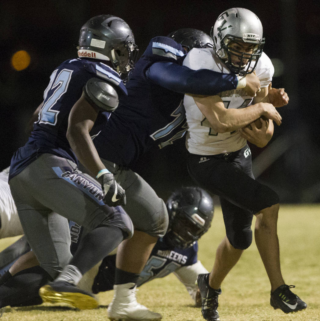 Green Valley's Desmond Bowers (44) runs the ball against Canyon Springs in the playoff football game at Canyon Springs High School in Las Vegas, Thursday, Nov. 9, 2017. Green Valley won 14-7. Erik ...
