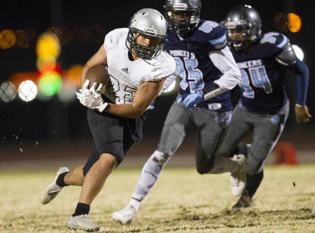 Green Valley's Noah Hawthorne (22) runs the ball against Canyon Springs in the playoff football game at Canyon Springs High School in Las Vegas, Thursday, Nov. 9, 2017. Green Valley won 14-7. Erik ...