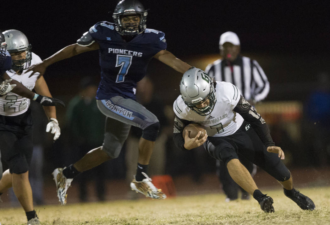 Green Valley's quarterback A.J. Barilla (7) runs the ball against Canyon Springs in the playoff football game at Canyon Springs High School in Las Vegas, Thursday, Nov. 9, 2017. Green Valley won 1 ...
