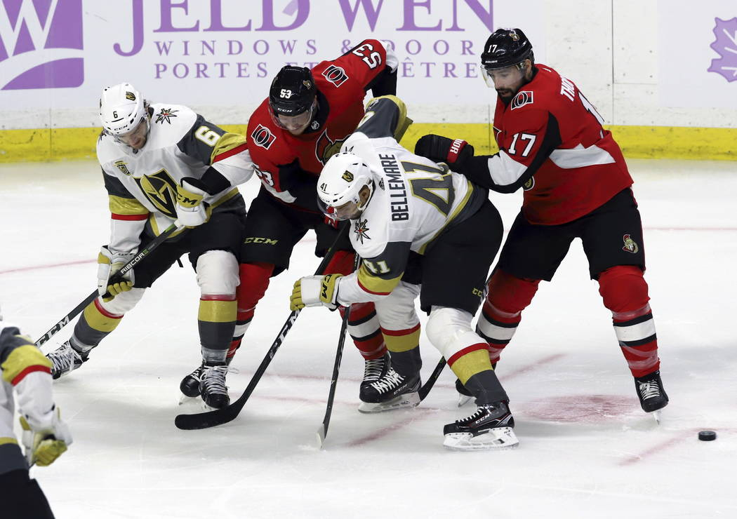 Vegas Golden Knights defenseman Colin Miller (6) and left wing Pierre-Edouard Bellemare (41) along with Ottawa Senators right wing Jack Rodewald (53) and center Nate Thompson (17) look for a loose ...