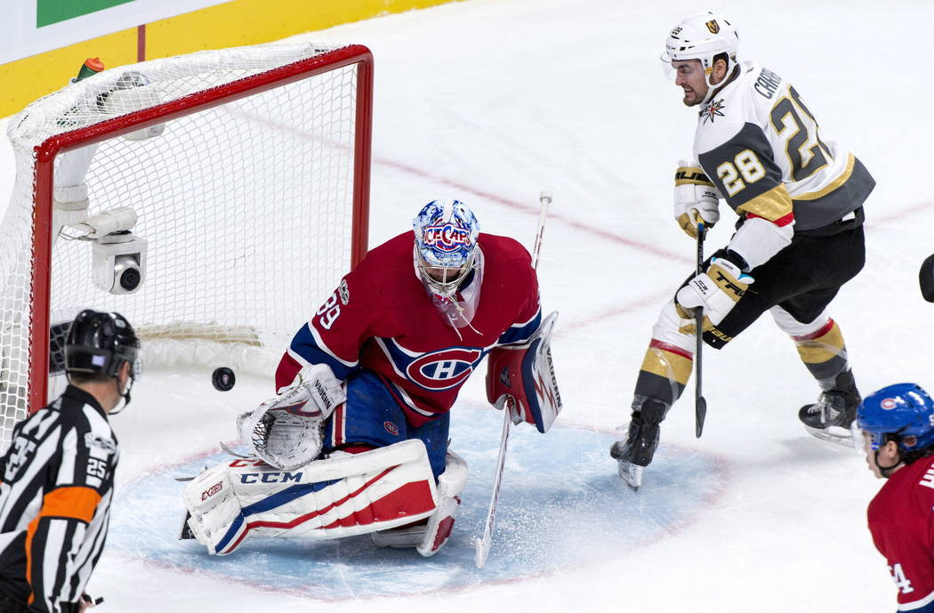 Montreal Canadiens goalie Charlie Lindgren stops Vegas Golden Knights' William Carrier during the second period of an NHL hockey game, Tuesday, Nov. 7, 2017, in Montreal. (Paul Chiasson/The Canadi ...
