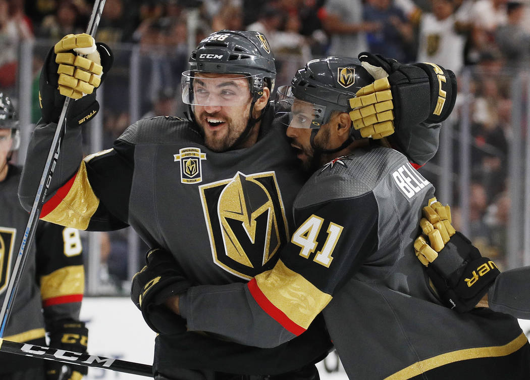 Vegas Golden Knights' William Carrier, left, and Pierre-Edouard Bellemare celebrate after Bellemare scored against the Chicago Blackhawks during the second period of an NHL hockey game Tuesday, Oc ...