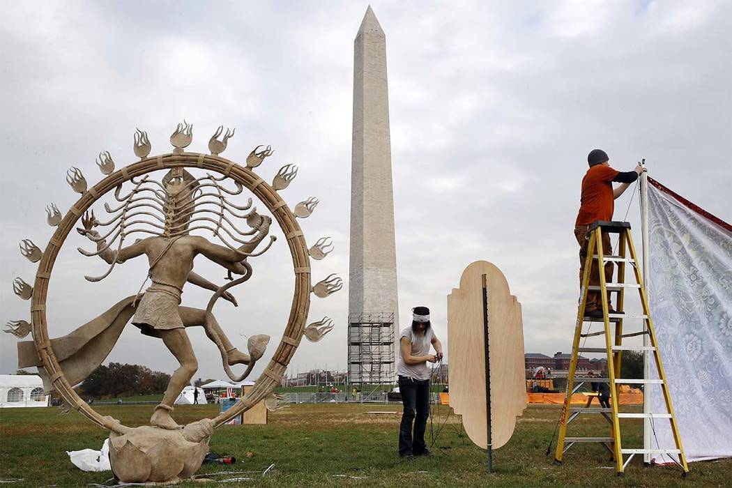 "Workers install ""Nataraja"" artwork for Catharsis on the Mall, Thursday, Nov. 9, 2017, an event that plans to bring a taste of Burning Man to the National Mall in Washington. The Catharsis on the M ..."