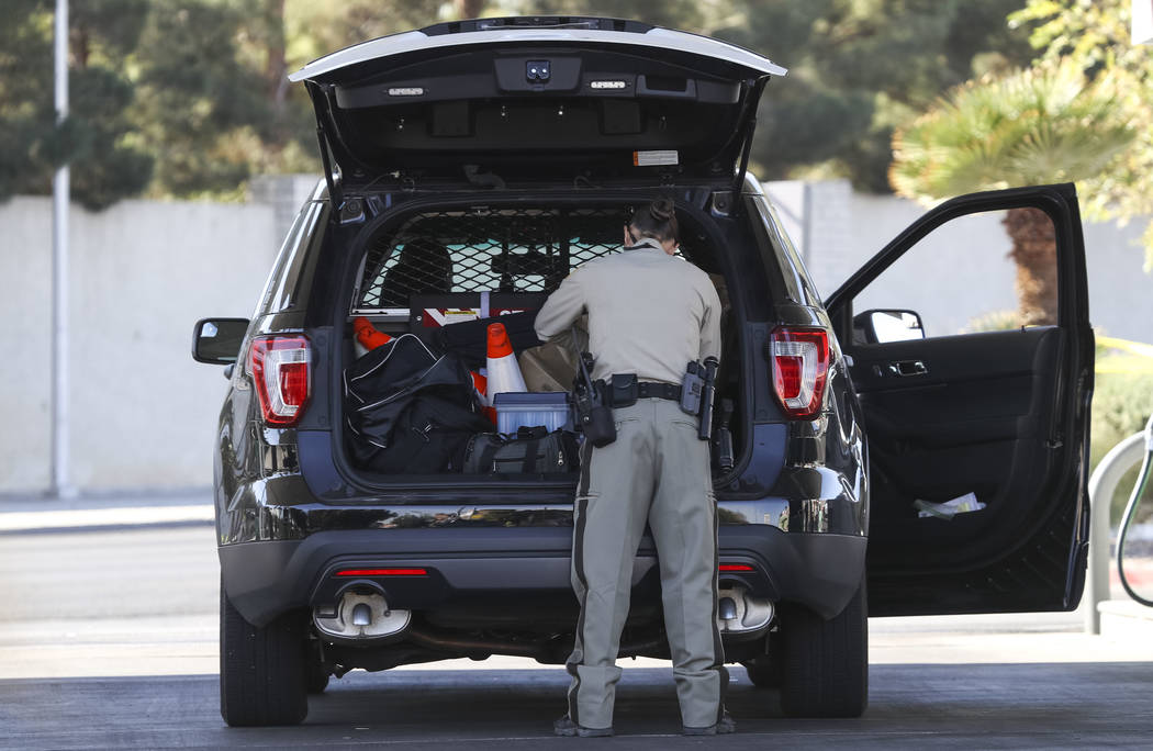 Las Vegas police gather in the parking lot of a 7-Eleven store at the intersection of East Sunset and South Pecos roads in Las Vegas, Friday, Nov. 10, 2017. Richard Brian Las Vegas Review-Journal  ...