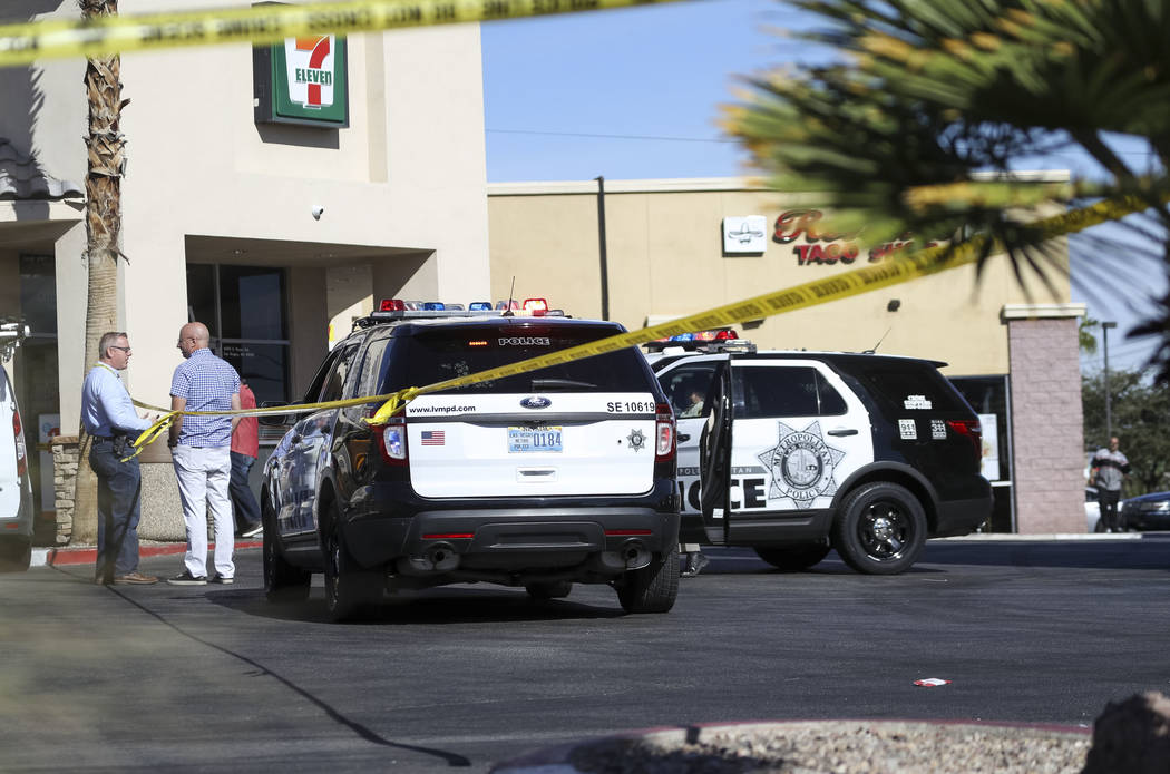 Las Vegas police and detectives gather in the parking lot of a 7-Eleven store at the intersection of East Sunset and South Pecos roads in Las Vegas, Friday, Nov. 10, 2017. Richard Brian Las Vegas  ...