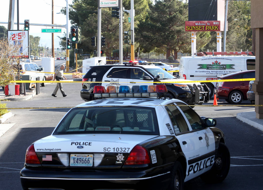 Las Vegas police investigate at the scene of a shooting on the corner of Sunset Road and Eastern Avenue Friday, Nov. 10, 2017. One man was dead and another in critical condition after they shot ea ...