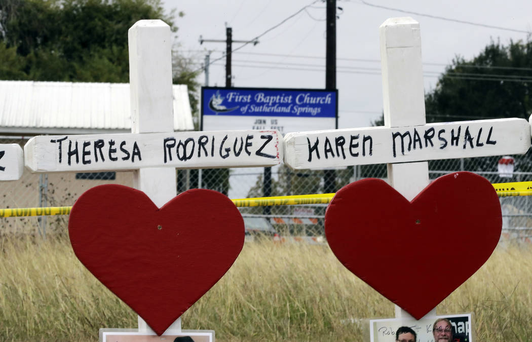 Crosses showing shooting victims names stand near the First Baptist Church on Thursday, Nov. 9, 2017, in Sutherland Springs, Texas. A man opened fire inside the church in the small South Texas com ...