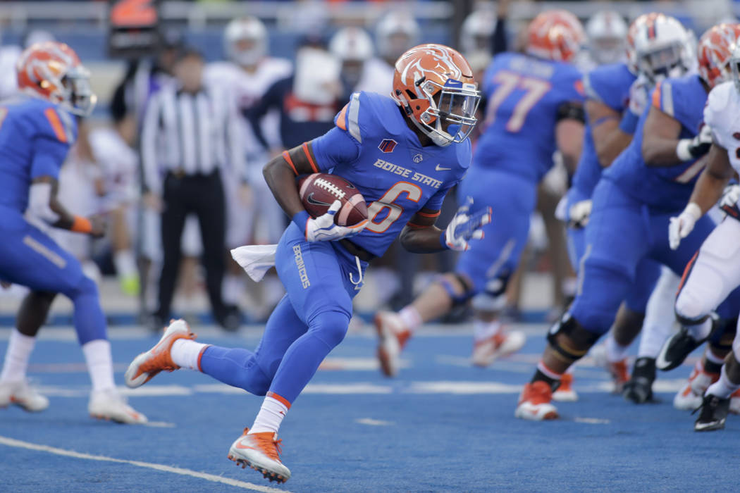 Boise State wide receiver CT Thomas (6) runs the ball during the first half of an NCAA college football game against Virginia in Boise, Idaho, on Friday, Sept. 22, 2017. (AP Photo/Otto Kitsinger)