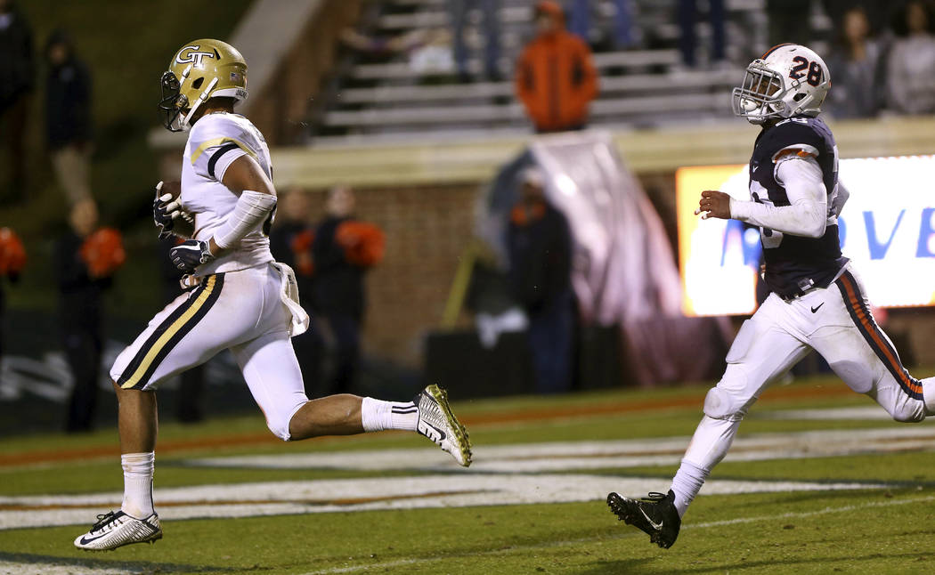 Georgia Tech's Ricky Jeune (2) scores a touchdown after a reception in the open field past Virginia's Brenton Nelson (28) during the second half of an NCAA college football game Saturday, Nov. 4,  ...