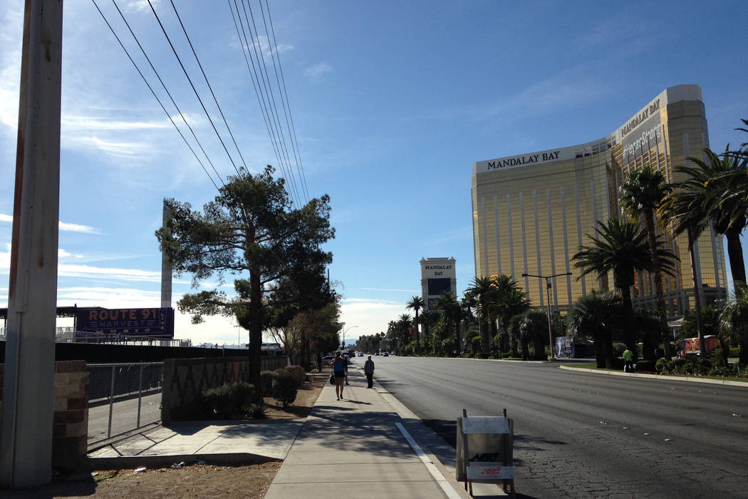Pedestrians use the sidewalk outside Las Vegas Village, site of the Oct. 1 mass shooting, on Friday, Nov. 10, 2017. Eli Segall Las Vegas Review-Journal
